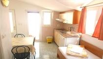 Sala da pranzo, cucina, camera da letto